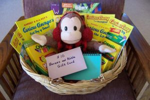 Gift basket with books, stuffed curious george, and $10 Barnes & Noble giftcard